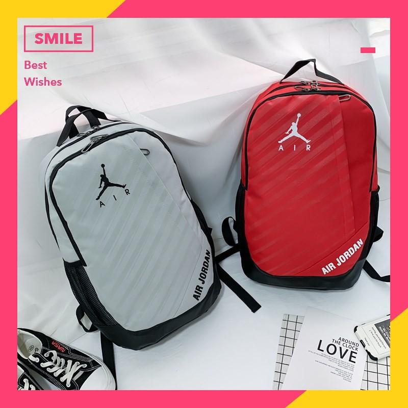 [ของแท้ 100%] Nike / Jordan แฟชั่นผู้ชายและผู้หญิงกระเป๋าเป้สะพายหลังคู่ใหม่บุคลิกภาพเกาหลีมัลติฟังก์ชั่กระเป๋าถือกระเป๋าเป้สะพายหลังเดินทางท่อง