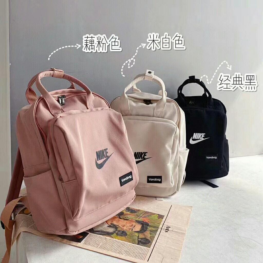 Nikeกระเป๋าเป้สะพายหลังnike2 ใหม่สีชมพูกระเป๋าถือหวานแว๋วกระเป๋านักเรียนนักศึกษาลมกระเป๋าสะพายเดินทางกระเป๋าคอมพิวเตอร์