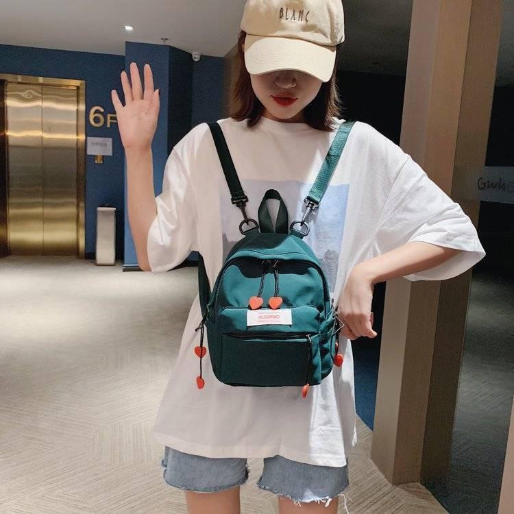 ◇▥รุ่นเกาหลีกระเป๋าใบเล็กหญิง 2021 ฤดูร้อนใหม่สไตล์ตะวันตกกระเป๋าเป้ผ้าใบแฟชั่นสาวกระเป๋าเดินทางกระเป๋าเป้นักเรียนจัดส