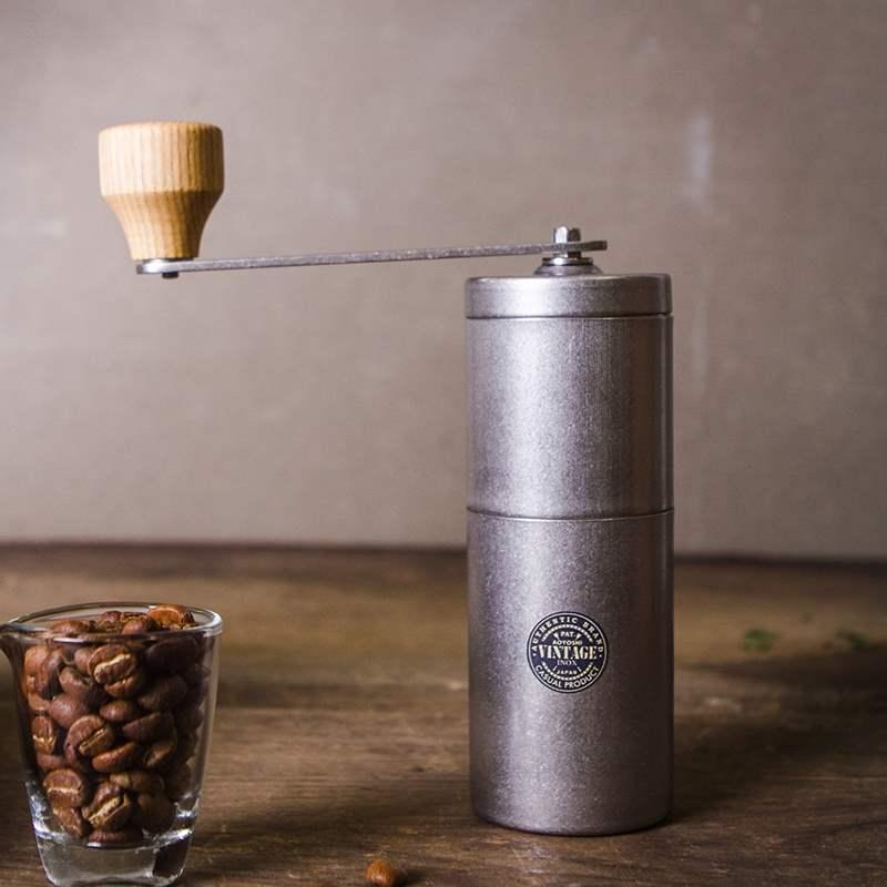 ญี่ปุ่นQingfangทำย้อนยุคคู่มือเมล็ดกาแฟเครื่องบดบดถั่วปรับมือสั่นเครื่องบดผง