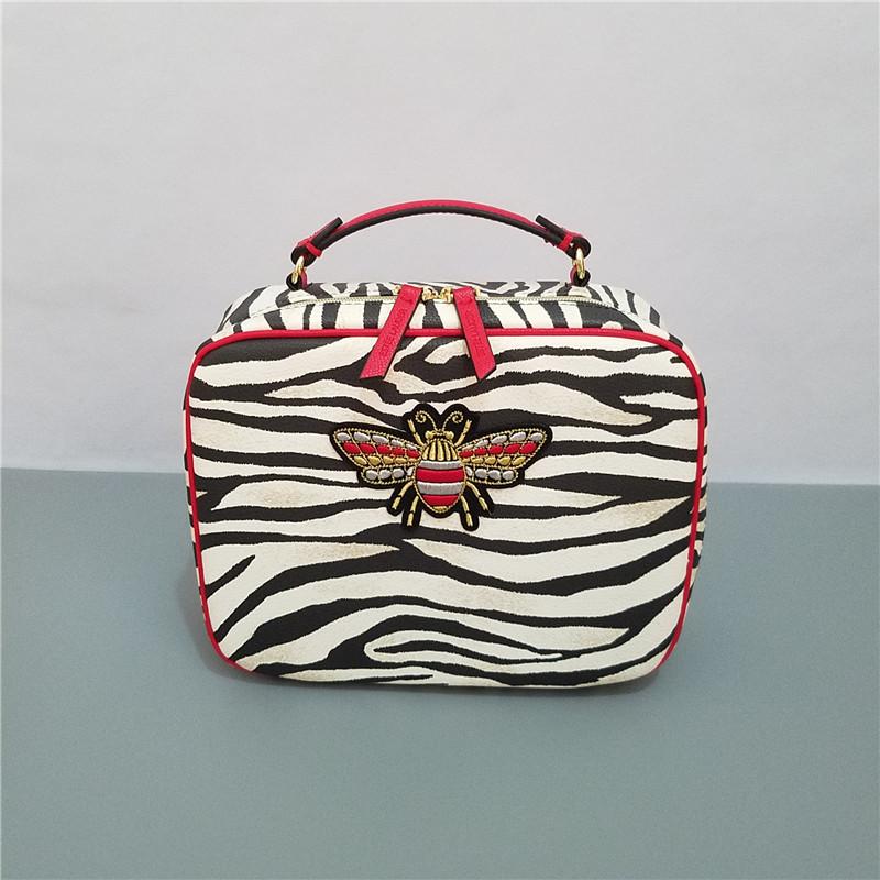 ❅✢จัดส่งฟรี Estee Lauder 20 กระเป๋าเดินทางลายม้าลายแบบพกพาสี่ชิ้นกรณีเครื่องสำอางที่มีกระเป๋าเครื่องสำอางสามใบกระเป๋าแต่