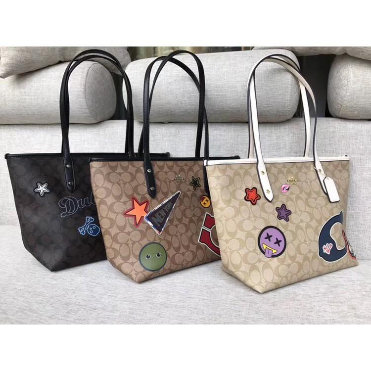 กระเป๋าผู้หญิงCoach กระเป๋าผ้าแคนวาสมีซิป ( Coach F 20911 )
