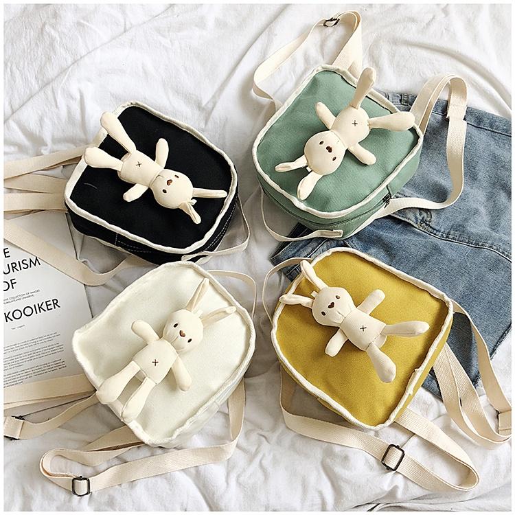 กระเป๋าเป้สะพายหลังผ้าใบสไตล์เกาหลีน่ารักสาวมินิกระเป๋าเป้ใบเล็กกระเป๋าเดินทางกระเป๋าตุ๊กตาหมี