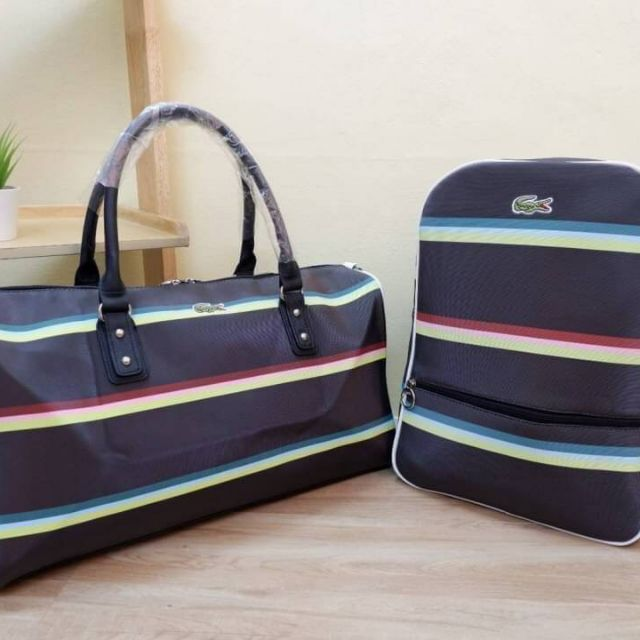 Lacoste กระเป๋าเดินทาง หรือ กระเป๋าเป้