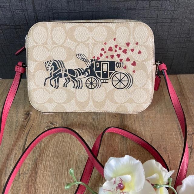 (ผ่อน0%) กระเป๋า สะพายข้าง MINI CAMERA BAG IN SIGNATURE CANVAS WITH HORSE AND CARRIAGE HEARTS MOTIF (COACH 91041) รถม้า