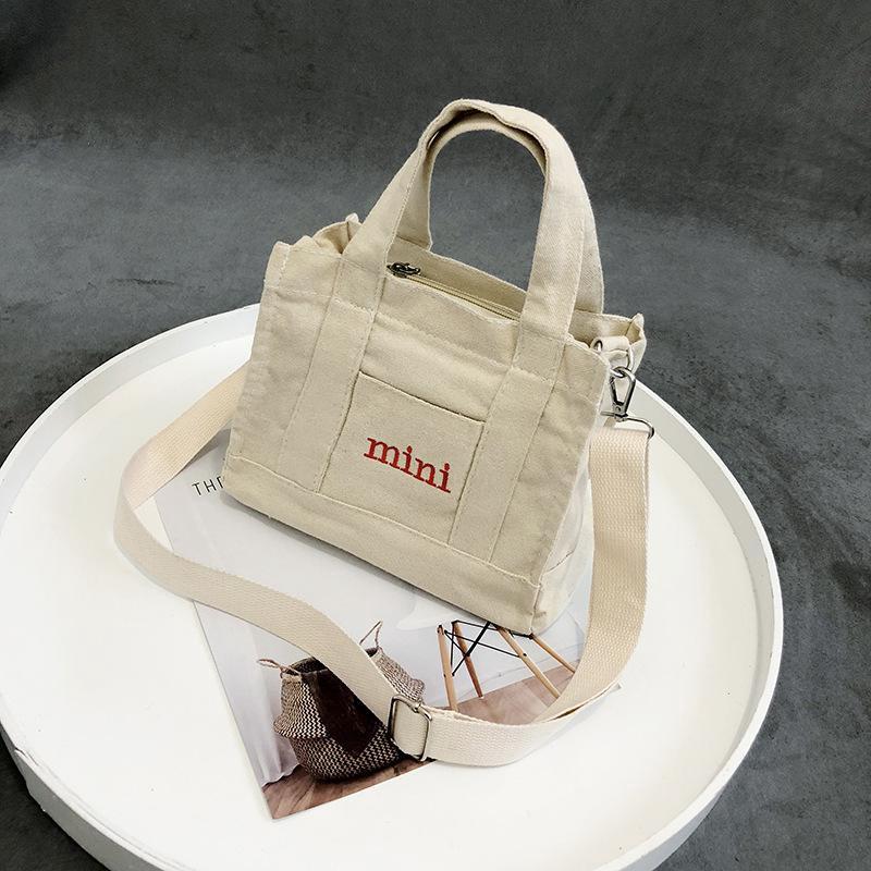 กระเป๋าผ้าใบสะพายไหล่แบบพกพา niche anello กระเป๋าสะพายข้าง coach พอ กระเป๋า sanrio gucci marmont gucci dionysus