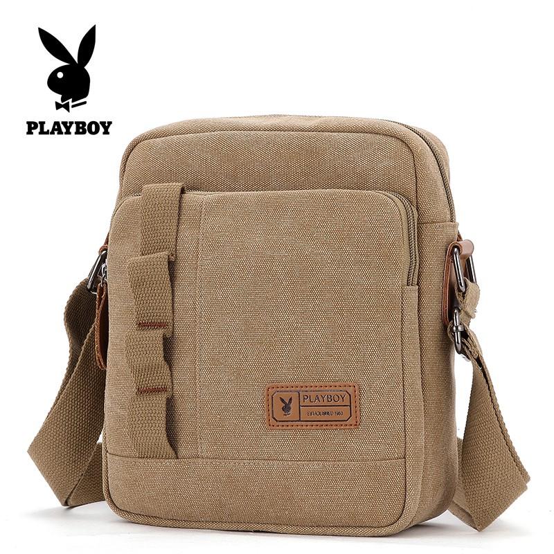 ☃㍿✲กระเป๋าผู้ชาย Playboy กระเป๋าสะพายข้างกระเป๋าสะพายข้างผู้ชายเกาหลีลำลองผ้าใบเดินทางย้อนยุคกระเป๋าใบเล็ก