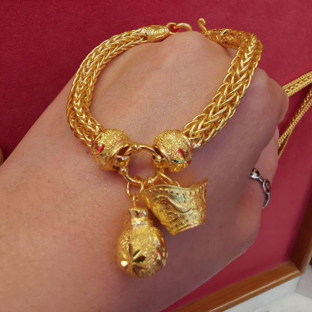 สร้อยมือทองห้อยกิมตุ้ง 96.5%  น้ำหนัก 2 บาท ยาว 18.5cm ราคา 59,800บาท