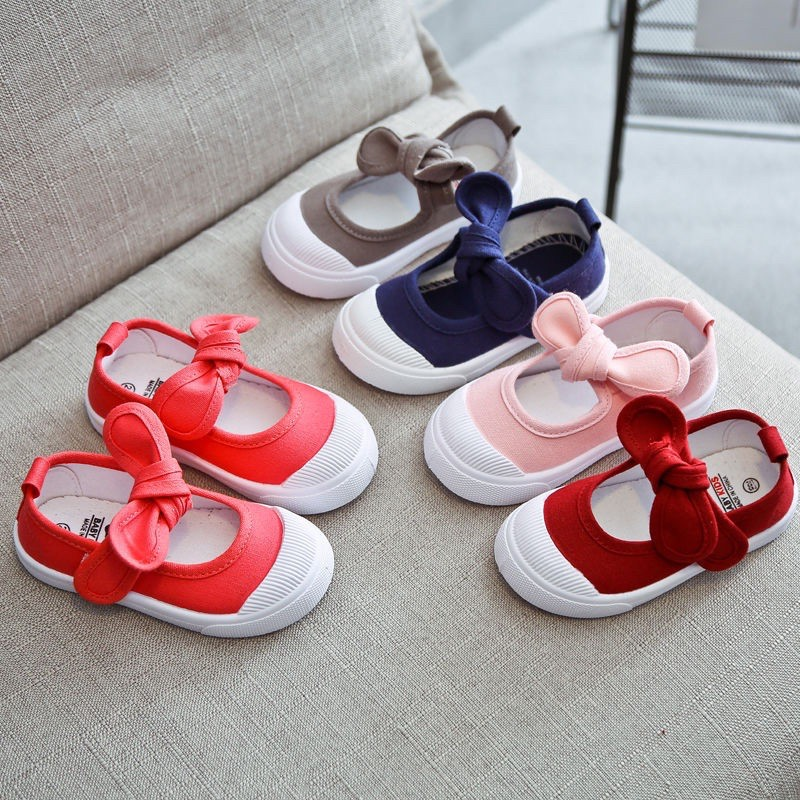 รองเท้า คัชชู (เด็กผู้หญิง)แฟชั่นไขว้โบว์ แบบสวม สีสันสดใส foSh
