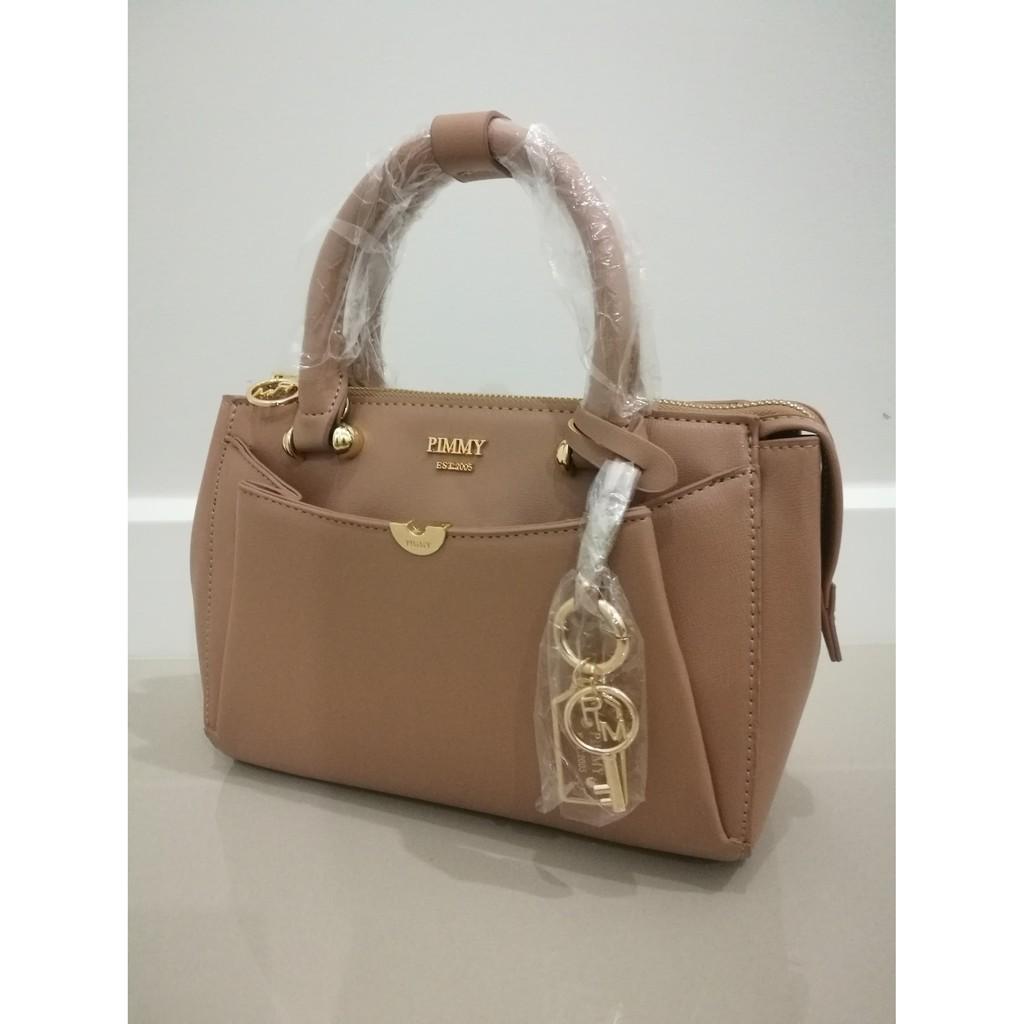กระเป๋า pimmy (พิมมี่) แท้ 💯% สีแอฟฟิคอต