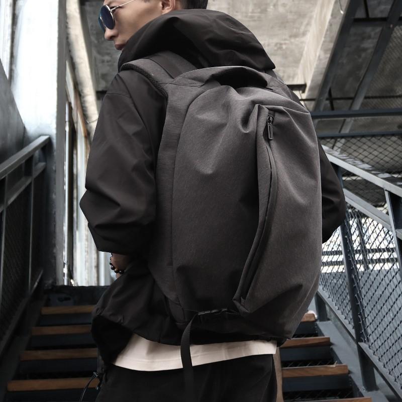 ✶△﹍กระเป๋าเป้ผู้ชายกระเป๋าเดินทางพักผ่อนเดินทางกระเป๋าเป้สะพายหลัง 15.6 นิ้วกระเป๋าคอมพิวเตอร์แบรนด์ไทด์แฟชั่นเรียบง่