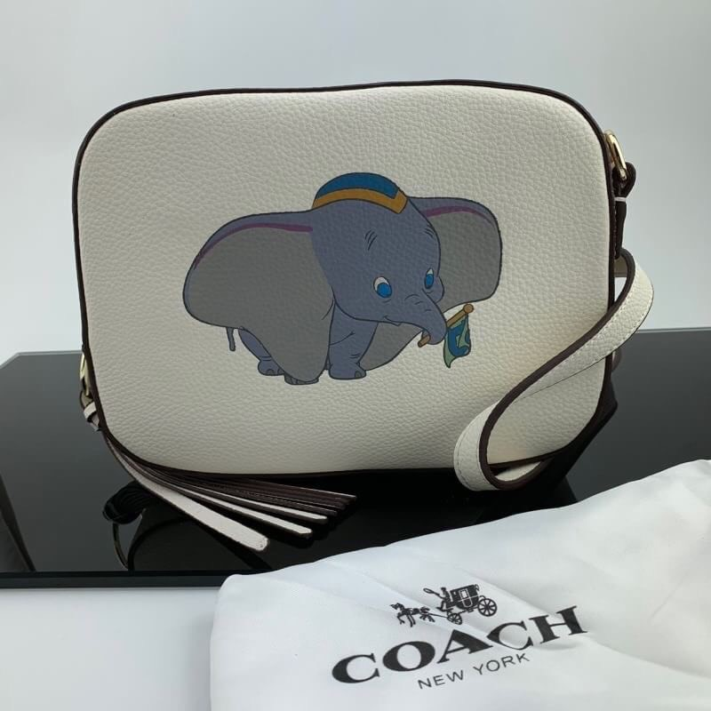 DISNEY X COACH CAMERA BAG WITH DUMBO กระเป๋าสะพายข้าง สีขาว ลายช้างดัมโบ้