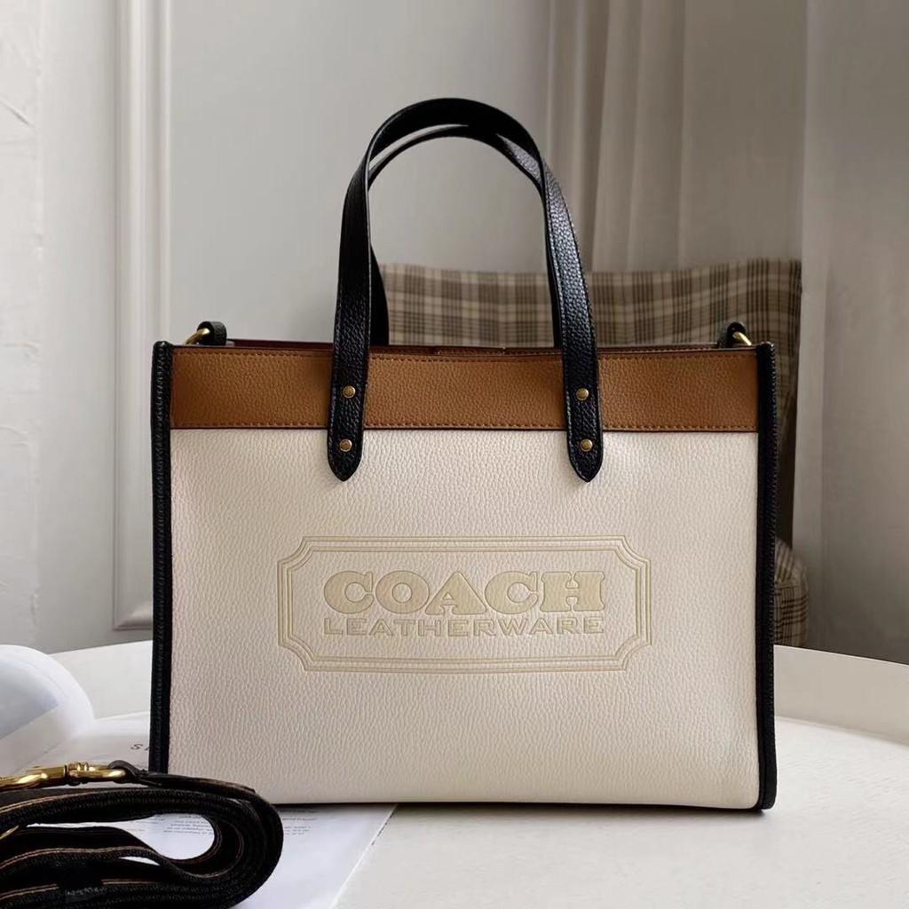 (ส่วนลดพิเศษ 10% ใช้โค้ด LPAW) Coach กระเป๋าถือผู้หญิง / กระเป๋าโท้ทผ้าแคนวาสสีบล็อค