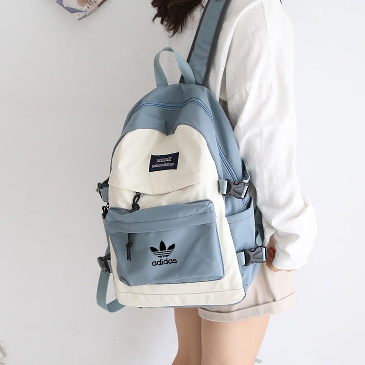 adidas Adidas Clover Backpack กระเป๋าเป้ผู้หญิง Korean Version Wild 2020 New Fashion Oxford Men