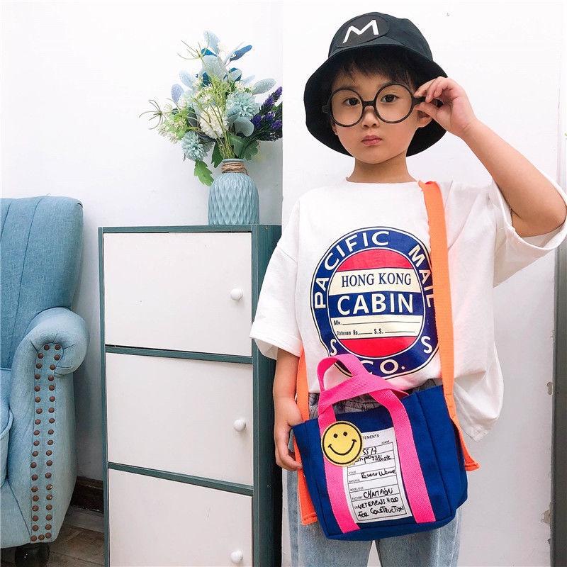 กระเป๋าคาดอก❄☜♨2021 กระเป๋าสะพายเด็กใหม่เกาหลีกระเป๋าเดินทางใบเล็กเด็กผู้หญิงกระเป๋าผ้าใบสาวแนวทแยงชนสีกระเป๋าอินเทรนด์