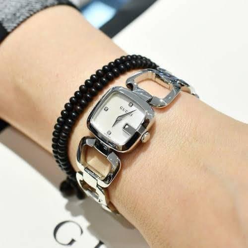 ของแท้ ราคา 28,900 บาท Gucci G-timeless watch  หน้าปัดขาวมุข ฝั่งเพชร 3 เม็ด ตัวเรือนสีทอง ✅หน้าปัด 24 มม ✅ Swiss made