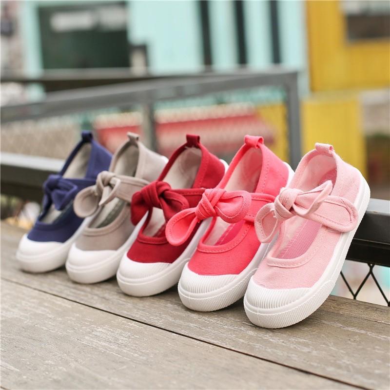 รองเท้า คัชชู (เด็กผู้หญิง)แฟชั่นไขว้โบว์ แบบสวม สีสันสดใส