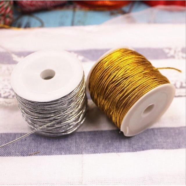 ดิ้นเงินดิ้นทองแบบยางยืดราคาถูก ขนาด 1 มิลลิเมตร ยาว 25 เมตร แพ็ค 1 ม้วน