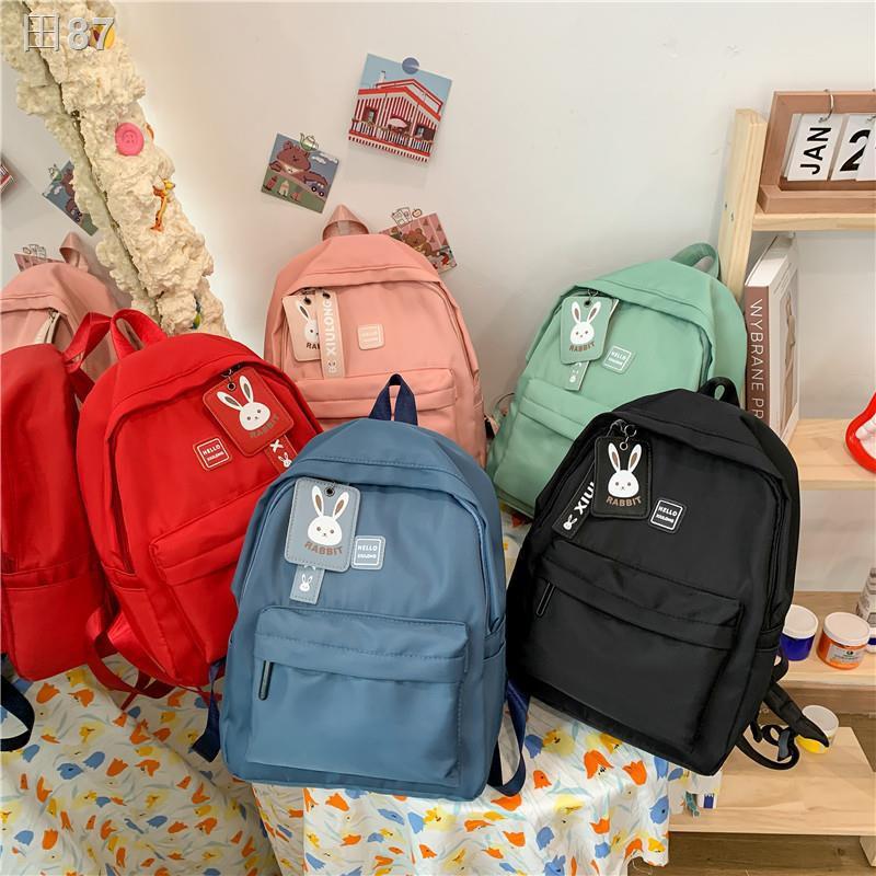 รุ่นเกาหลีกระเป๋านักเรียนเสริมน้ำหนักเบาสำหรับเด็กประถมชายและหญิงเดินทางกระเป๋าเป้ใบเล็กแฟชั่นกันน้ำ กระเป๋าเป้