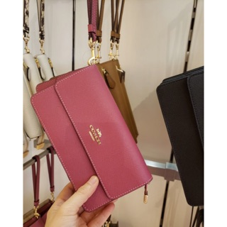 Review พร้อมส่ง แท้ 🇺🇸100% New Coach กระเป๋าสตางค์ ใบยาว รุ่น FOLDOVER WRISTLET WITH SIGNATURE CANVAS DETAIL (COACH F76757)