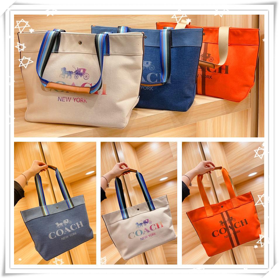 Coach กระเป๋าผ้าแคนวาส 21 New Arrival Super Hot C Home Shopping Bag Tote Bag กระเป๋าผ้าแคนวาสเนื้อขนาด 43 29 ซม