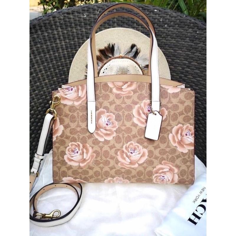✈️พร้อมส่ง กระเป๋า Coach #31667 Charlie Carryall In Signature Rose Print TAN/CHALK/BRASS สวยมากๆ งาน Shop มีถุงผ้า